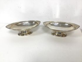 A pair of Edwardian Sheffield silver navette shaped footed dishes, both inscribed Sorley, Glasgow to