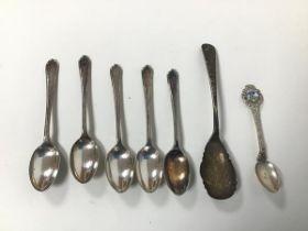 An Edwardian Sheffield silver spoon (14.5cm) (22.35g), a Tanga souvenir spoon, stamped 800 verso (