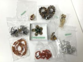 A collection of costume jewellery including a brooch by Joseff of Holywood (5.5cm), makers including