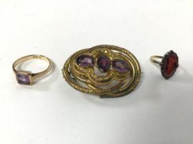 A Victorian gilt metal gem set openwork brooch (4cm), a 9ct gold amethyst ring (2.35g) and a
