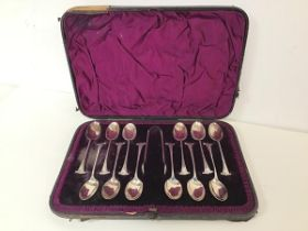 A Walker & Hall 1920s set of twelve coffee spoons with sugar nips, in original box (18cm x 26cm)