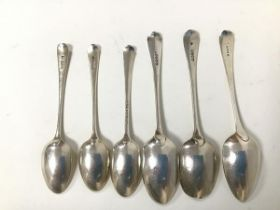 A collection of late 18thc/early 19thc spoons including three serving spoons, three table spoons,