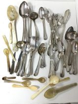 A large assortment of Epns flatware including forks, knives, spoons, serving spoons, ladles and an