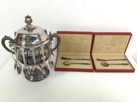 An Epns caviar server, with two C scroll handles to sides and twelve spoon holders, lacking one
