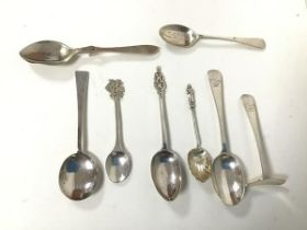 An assortment of silver spoons, including one inscribed William Francis Templeton Anderson, March