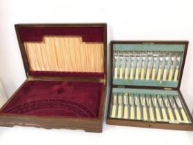 A 1930s/40s Walker & Hall cutlery canteen with a set of twelve bone handled knives and forks (6cm