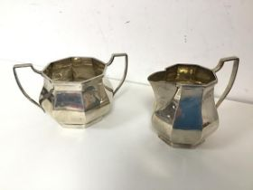 A 1920s Birmingham silver sugar bowl and milk jug (sugar bowl: 7.5cm x 13cm x 9cm) (combined: 258.