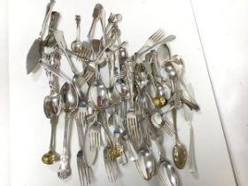 An assortment of Epns flatware including dinner forks, spoons, sugar nips, fish slices, souvenir