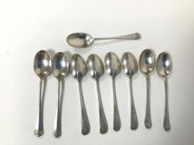 A set of nine 1921 Sheffield silver teaspoons, initialled M (combined: 207.53g)