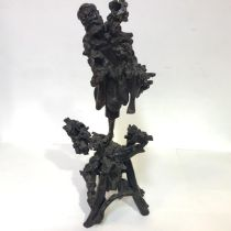 A large Chinese rootwood carving, late 19th century, of a standing man modelled with one leg raised,