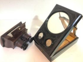 """A French table top zograscope, ebonised, inscribed """"Exposition Universelle 1878"""", the twin"""