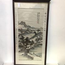 A large Chinese embroidered silk panel, probably late 19th century, worked in polychrome threads