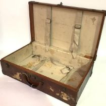 A Louis Vuitton brown leather suitcase, c. 1920, with studded corner guards, the snap locks and