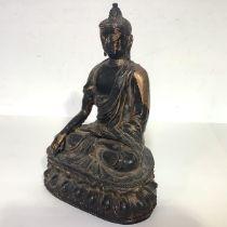 A Chinese gilt-bronze figure of Buddha Sakyamuni, probably Ming Dynasty, seated in meditative