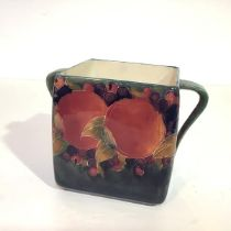 William Moorcroft, a Pomegranate pattern biscuit box (lacking cover), with shaded green ground, with