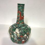 A Chinese porcelain reticulated vase, 19th century, of bottle form, decorated in relief with figures