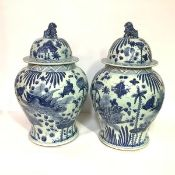 A pair of large Chinese blue and white porcelain baluster jars and covers, 20th century, each