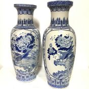 A pair of Chinese blue and white porcelain floor-standing baluster vases, 20th century, each
