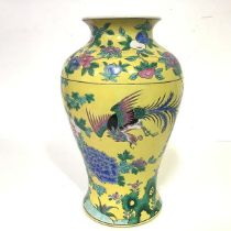 A Chinese famille jaune porcelain baluster vase, painted with pheasants amidst flowering boughs
