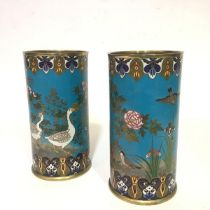A striking pair of Japanese cloisonne enamel vases, c. 1900, of cylindrical form, one decorated with