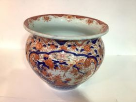 A Japanese Imari palette jardiniere, early 20th century, decorated in a characteristic palette