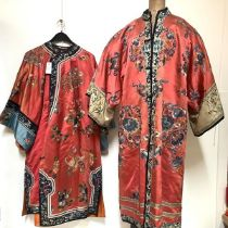 """Two Chinese embroidered silk robes, probably c. 1900: the first with """"mandarin"""" collar, of coat"""