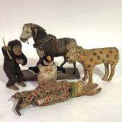 A group of early and mid-20th century animal toys comprising: a small ponyskin pony on a wooden
