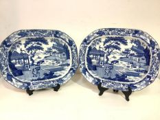 A pair of pearlware platters or ashets, c. 1820-30, Andrew Stevenson, in the Chinese Traders