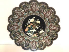A striking Japanese cloisonne charger, c. 1900, of lobed circular form, the well decorated with