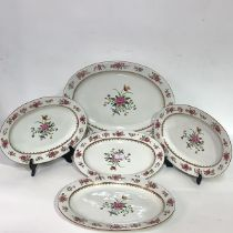 A set of five early 19th century Derby porcelain graduated serving plates, each enamel polychrome