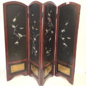 A Chinese mother of pearl and abalone mounted table screen, of four leaves, painted and applied with