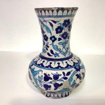 A Persian pottery vase, late 19th century, of baluster form with flared neck, decorated in blue