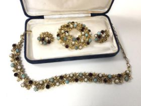 A group of costume jewellery by Jewelcraft including necklace, clip on earrings and brooch (
