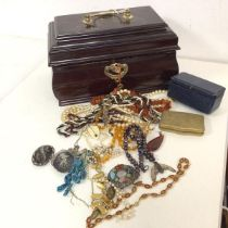 An assortment of costume jewellery including necklaces, brooches, pendants, two niello silver