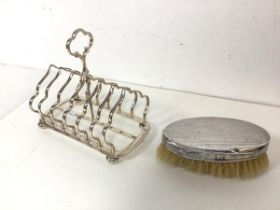 An Edwardian Birmingham silver backed clothes brush (13cm x 7cm) and an Epns large toastrack on