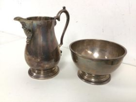 A white metal jug with handle and a footed bowl, both marked silver, with other markings (jug: 14cm)
