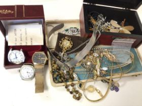 A group of costume jewellery with some silver including necklaces, paste pearls, watches, charms