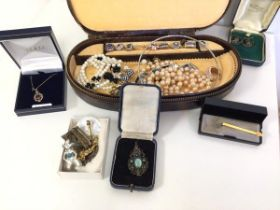 An assortment of costume jewellery including paste pearls, mother of pearl bracelet, multiple rings,