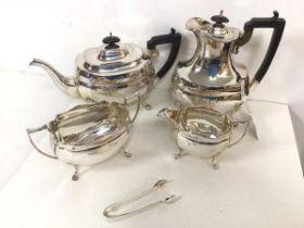 An Epns tea and coffee service with teapot, coffee pot (21cm), milk jug, sugar bowl, sugar nips (5)