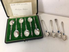 A set of six 1953 Chester silver apostle coffee spoons in original box, and four other silver coffee
