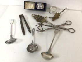A Birmingham silver pierced napkin ring inscribed Floss in original jewellery box and another silver