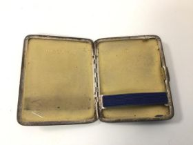 An Edwardian Sheffield silver cigarette case engraved Bob Xmas 1923 to front (103.35g)