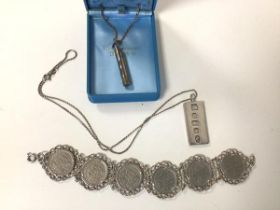 A 1970s Sheffield silver ingot, stamped with Queen's head, on silver chain (combined: 19.83g),