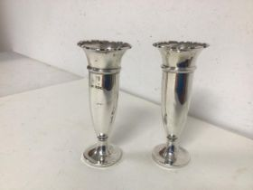 A pair of Edwardian Sheffield silver bud vases, with flared scalloped rim, maker B&S with wooden