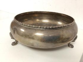 A footed bowl with beaded edge and lion paw feet, marked sterling silver to base (8cm x 22cm) (