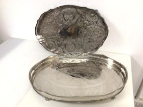 An oval drinks tray with raised pierced edge and handles to side, on claw feet (7cm x 6cm x 31cm)
