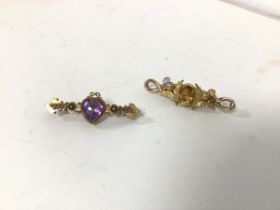 A 15ct gold bar brooch with heart cut amethyst (4.5cm) and another yellow metal bar brooch with