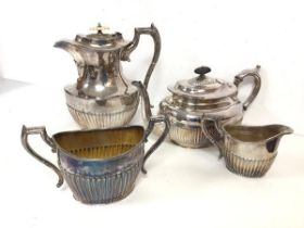 An Epns set of coffee or hot water jug, milk jug and sugar bowl, with gadrooned base (jug: 21cm) and