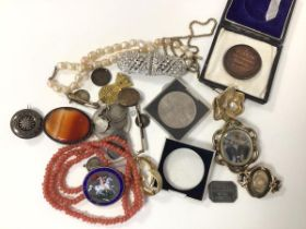 A collection of costume jewellery including a George III 1819 coin brooch with enamel to one side,