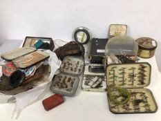 Fishing interest: a collection of fishing equipment including lines, flies, hooks and a fishing reel